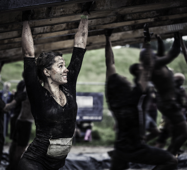 Female athlete competing in an obstacle course