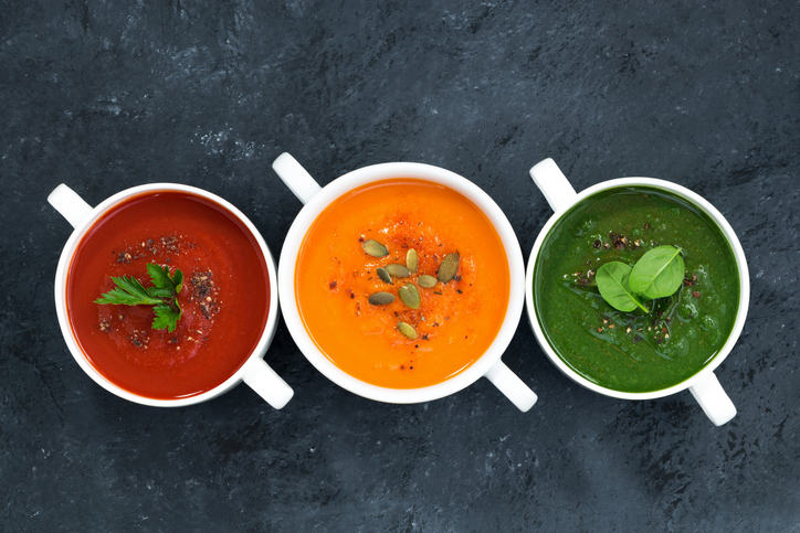 assortment of soup on a dark background, top view
