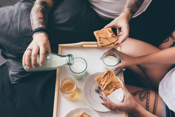 couple having breakfast together in bed
