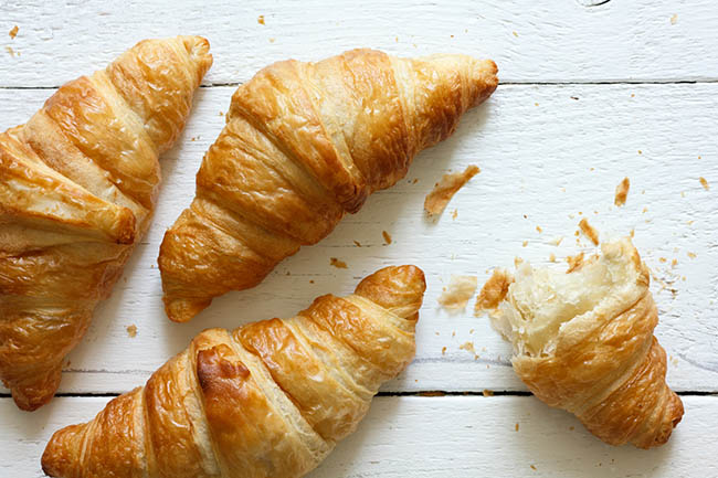 flaky crescent rolls on a white background