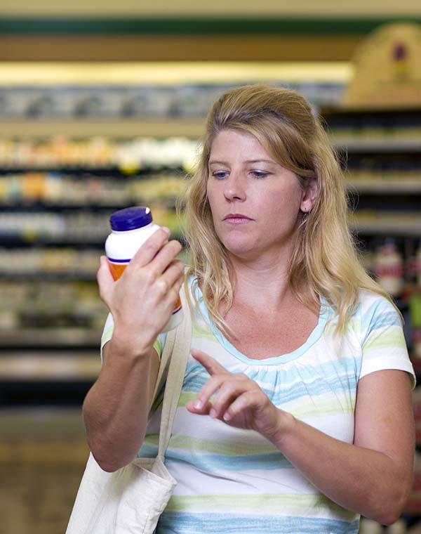 Woman in Store Looks at Supplements