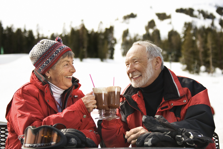 Couple outdoors with coffee at Lake Tahoe