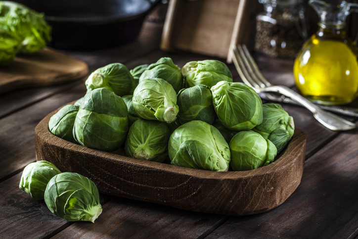 Fresh organic Brussels sprouts in a wooden tray