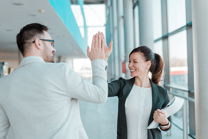 colleagues high-five at work