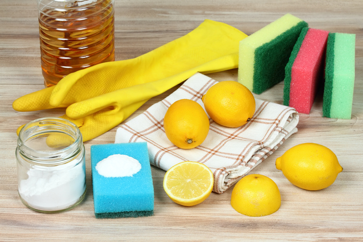 natural cleaning products, including lemons, baking soda, salt, vinegar, gloves and sponges