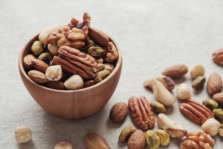 mixed nuts in a wooden bowl