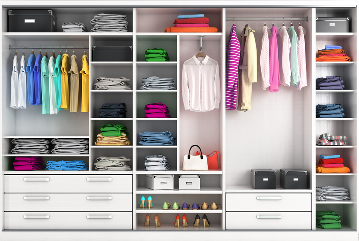 a large closet with an organizational system