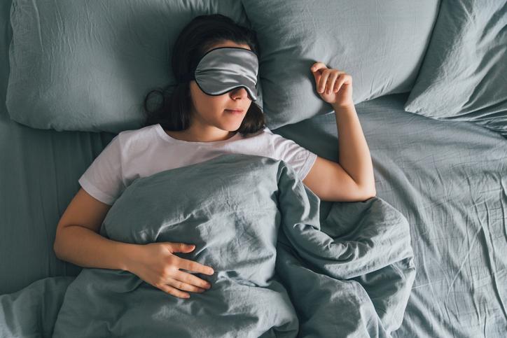woman sleeping wearing eye mask