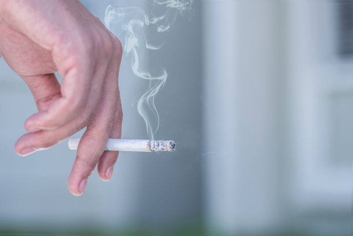 hand holding a smoking cigarette