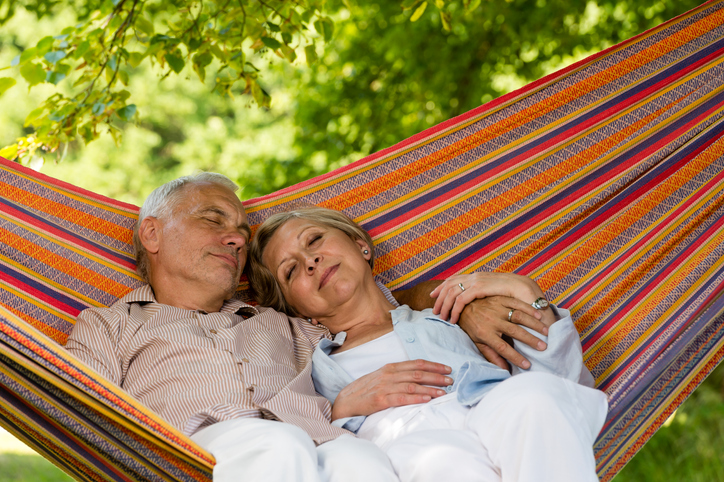 Senior couple sleeping in a hammock