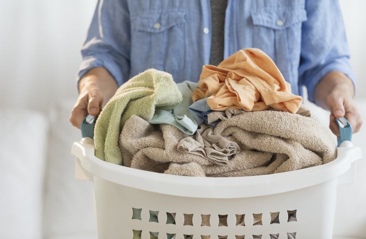 man holding a laundry basket