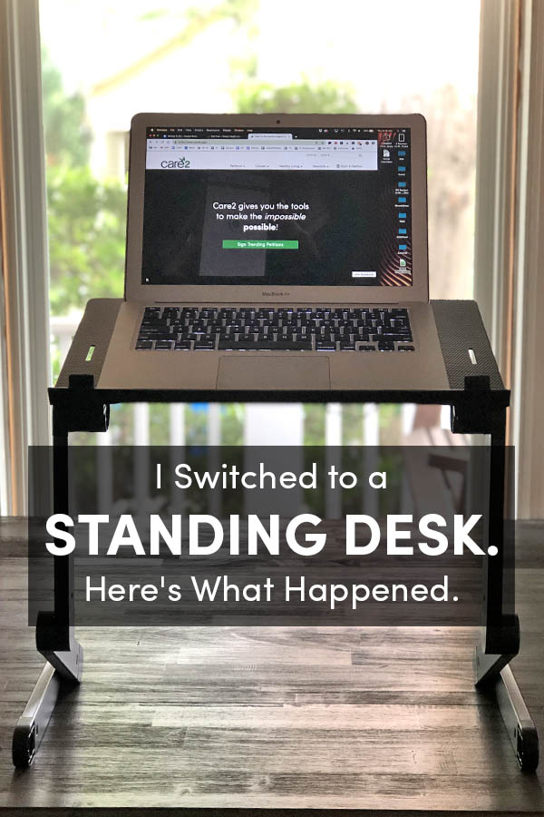 my laptop on my standing desk in front of a window