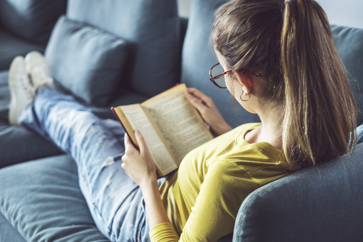 Young woman is reading book