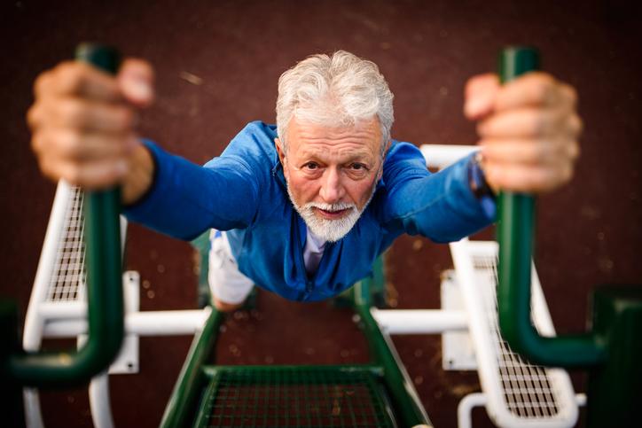 Senior man exercising at the park.