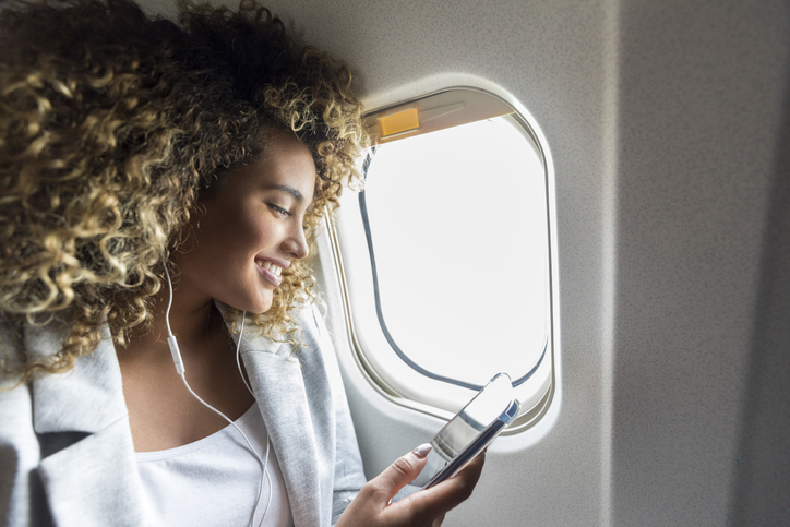 Woman choose music during flight