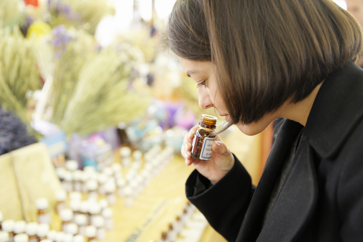 Smelling Essential Oils on a Market Stall