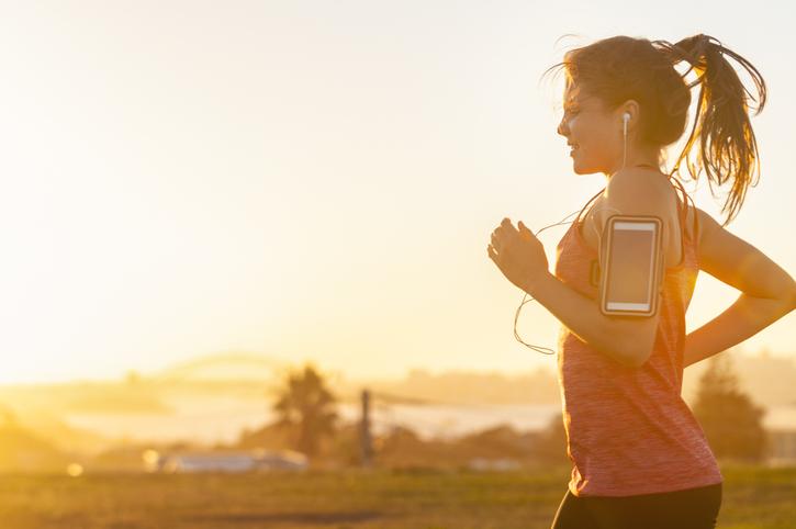 woman jogging in the morning sun