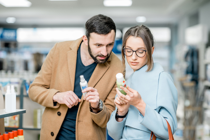 Couple choosing medicine in the pharmacy store