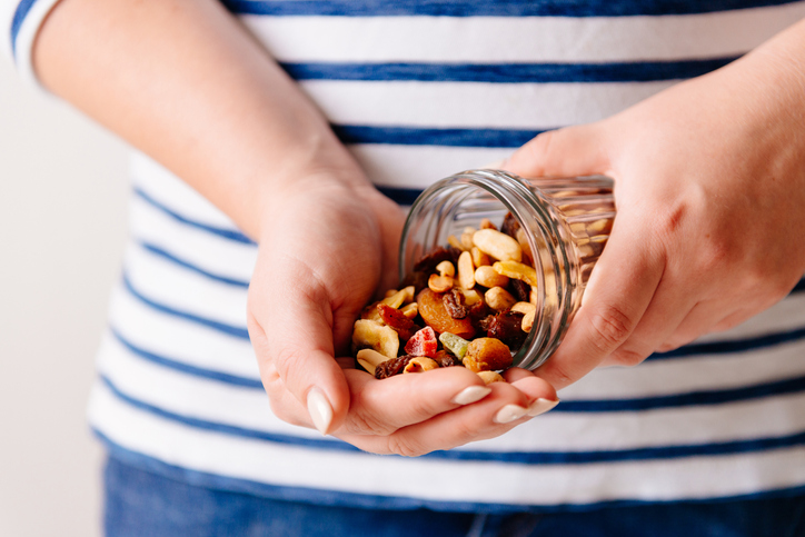 Nuts and dried fruits in hands. Cooking