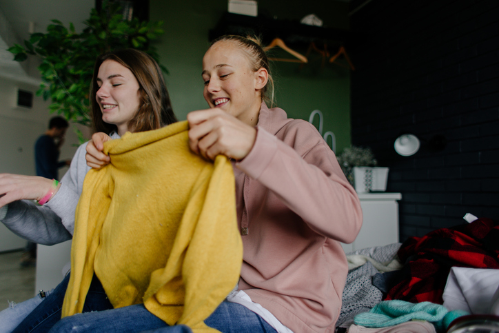 Teenagers exchanging clothes