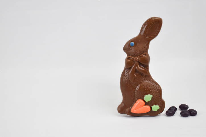 Chocolate Easter Bunny and Jelly Beans Candy Poop on White Background