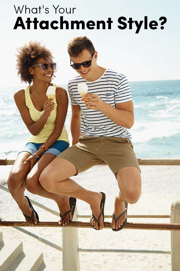 A young couple relaxing on the promenade while eating ice cream