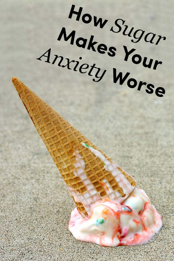 """Dropped Ice Cream Cone on the ground with text overlay that says: """"How Sugar Makes Your Anxiety Worse"""""""